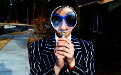 Woman with magnifying glass searching